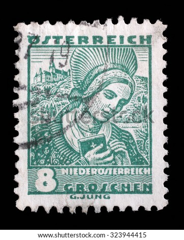 AUSTRIA - CIRCA 1934: A stamp printed by AUSTRIA shows Woman from Lower Austria (Niederosterreich), Traditional folk costume, circa 1934. - stock photo