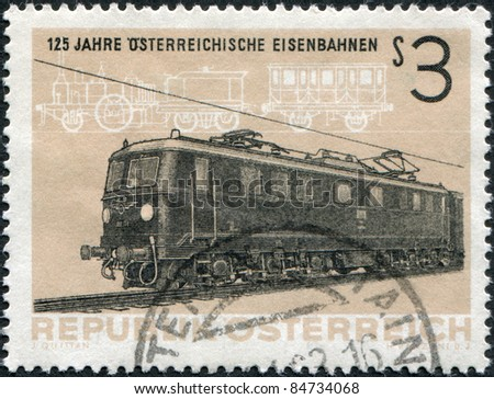 "AUSTRIA - CIRCA 1962: A stamp printed in Austria, devoted to 125th anniversary of Austrian railroads, depicted Electric Locomotive BR1010 and Steam Locomotive ""Austria"", circa 1962"