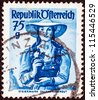 "AUSTRIA - CIRCA 1948: A stamp printed in Austria from the ""Provincial Costumes"" issue shows a woman from Steiermark Salzkammergut, circa 1948. - stock photo"