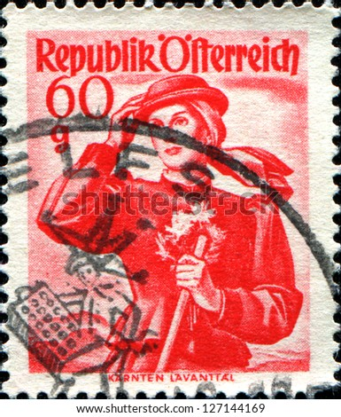 "AUSTRIA - CIRCA 1948: A stamp printed in Austria from the ""Provincial Costumes"" issue shows a woman from Karnten Lavanttal, circa 1948"