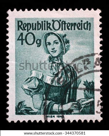 "AUSTRIA - CIRCA 1948: A stamp printed in Austria from the ""Provincial Costumes"" issue shows a woman from Vienna (1840), circa 1948."