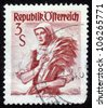 "AUSTRIA - CIRCA 1949: A stamp printed in Austria shows a woman in the Austrian national dress , inscription ""Burgenland"" from the series ""Costumes"", circa 1949 - stock photo"