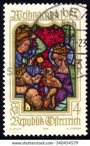 AUSTRIA - CIRCA 1980: A stamp printed in Austria, shows Adoration of Kings window parish church Viktring, Chrsitmas series, circa 1980 - stock photo