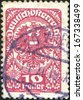 AUSTRIA - CIRCA 1919: A stamp printed in Austria shows Coat of arms, ornament and eagle, circa 1919  - stock photo