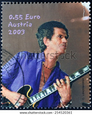 AUSTRIA - CIRCA 2003: A stamp printed in Austria shows image of famous English musician, composer, singer and songwriter Keith Richards, circa 2003. - stock photo