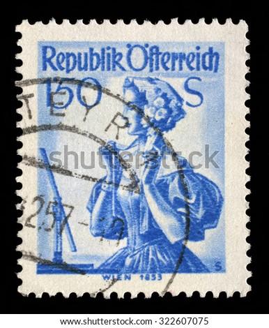 AUSTRIA - CIRCA 1951: A stamp printed in Austria shows image woman in national Austrian costumes, Vienna, 1853, series, circa 1951 - stock photo