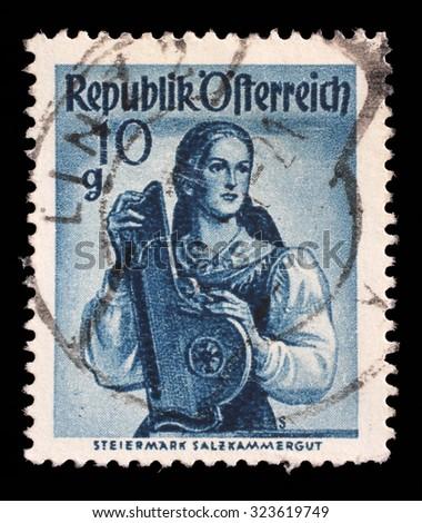AUSTRIA - CIRCA 1948: A stamp printed in Austria shows image woman in national Austrian costumes, Styria, Salzkammergut, series, circa 1948 - stock photo