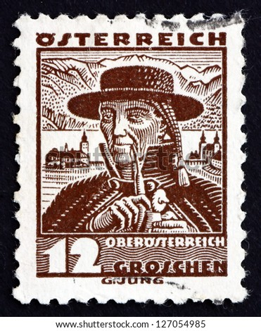 AUSTRIA - CIRCA 1934: a stamp printed in the Austria shows Man from Upper Austria, Regional Costume, circa 1934 - stock photo
