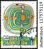 AUSTRIA - CIRCA 1975: a stamp printed in the Austria shows The Spiral Tree, by Friedenstreich Hundertwasser, circa 1975 - stock photo