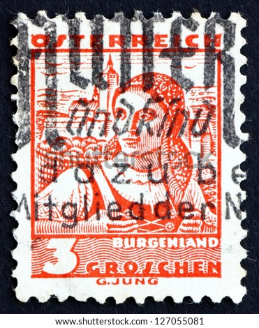 AUSTRIA - CIRCA 1934: a stamp printed in the Austria shows Woman from Burgenland, Regional Costume, circa 1934 - stock photo