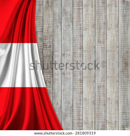 Austria  flag of silk and wood background