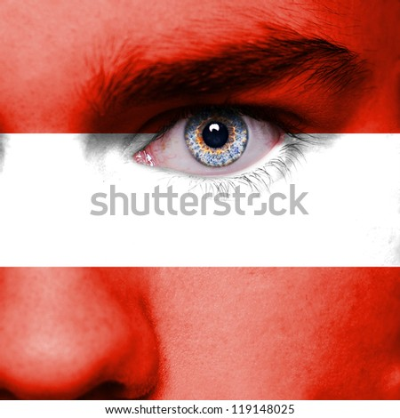 Austria flag painted on face - stock photo