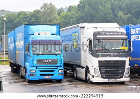 AUSTRIA - JULY 28, 2014: Modern trucks MAN TGA and Volvo FH12 at the interurban freeway. - stock photo