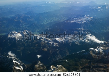 AUSTRIA - October 2016: The alps as seen from an airplane, plane view of mountains.