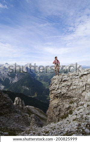 Austria, Salzburger Land, young man on mountain top - stock photo