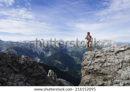 Austria, Salzburger Land, young man on mountain top