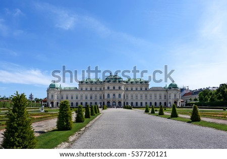 AUSTRIA, VIENNA - MAY 14, 2016: Photo back view on upper belvedere palace and garden with statue and flowers