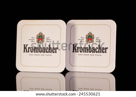 Austria,Wien - December 15,2014:Beermats from Krombacher beer.The brewery was founded on 4 February 1803 by Johannes Haas. His father Johann Eberhard Haas was running a tavern in Krombach.