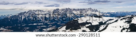 Austrian Alps, snow and forest covered adventure mountains with ski slopes. - stock photo