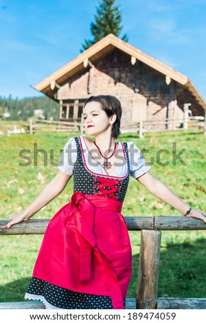 Austrian Beauty with traditional clothes in the Alps