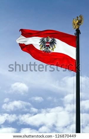 austrian flag against blue sky - stock photo