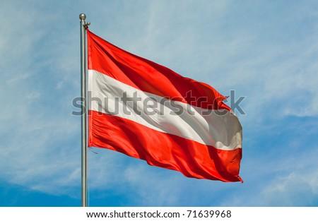 austrian flag on a pole over beautiful sky - stock photo