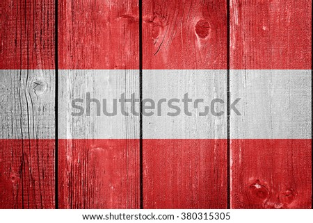 Austrian flag on wood background