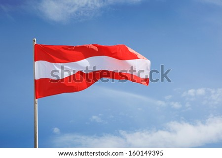 Austrian Flag waving on wind - stock photo