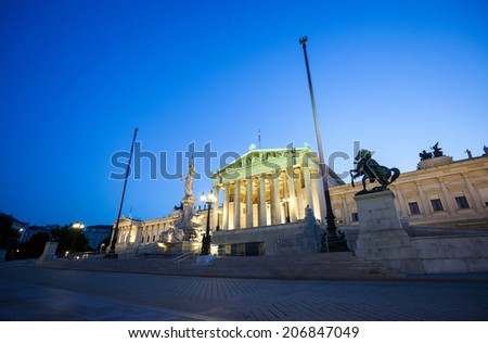 Austrian Parliament Building and The Athena Fountain at night.