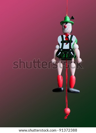 Austrian puppet on a degraded background in pink