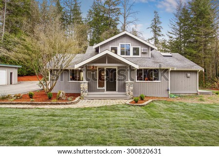 Authentic American home with greenery, and patched walkway. - stock photo