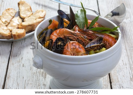 Authentic French Bouillabaisse fish soup with rouille on bread - stock photo