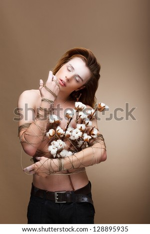 Authentic Handsome Man with Flowers standing in Studio. Real Person - stock photo