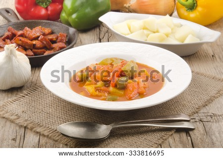 authentic hungarian letcho with potato and kolbasz - stock photo