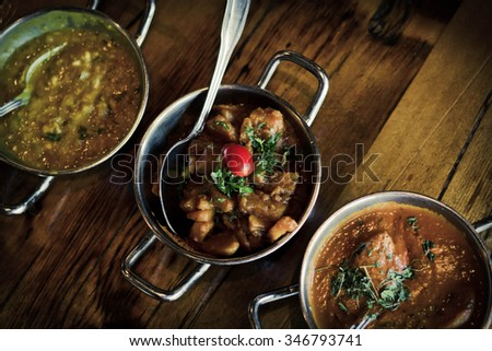 Authentic Indian cuisine popular dishes on table with selective focus - stock photo