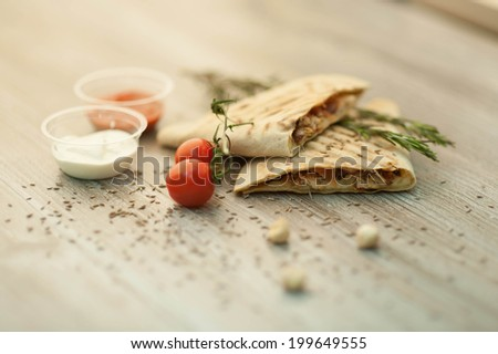 Authentic Mexican and chicken tacos, Mexican food, Mexican food meal in the restaurant on a wooden background, beef tacos. - stock photo