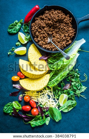 Authentic Mexican tacos ingredients, overhead on dark slate. - stock photo