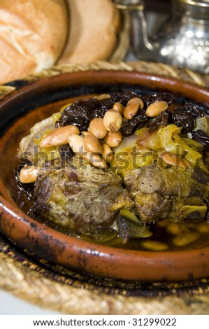 authentic moroccan lamb tagine with rasins almonds onions photographed in marrakesh Morocco - stock photo