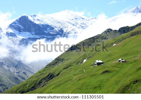 Authentic Mountain Wooden Cabin Hut in Alps - stock photo