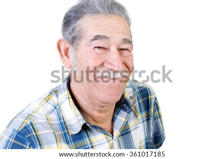 Authentic older Mexican man in casual flannel shirt with mustache grinning - stock photo