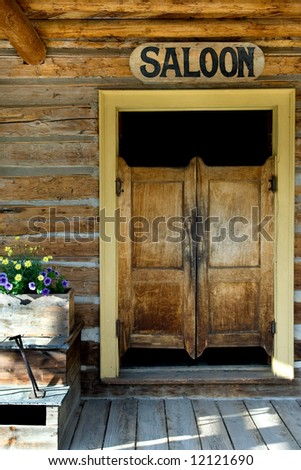 Authentic saloon doors of old western building in Montana ghost town - stock photo