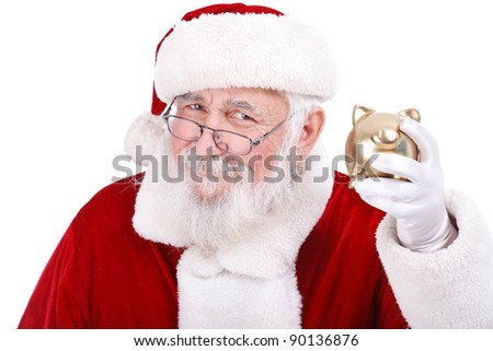 authentic Santa Claus holding gold piggy bank, Christmas budget - stock photo