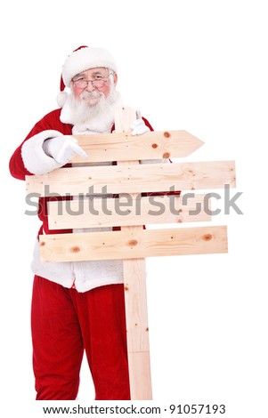 authentic Santa Claus pointing in wooden sing front him, isolated on white background - stock photo