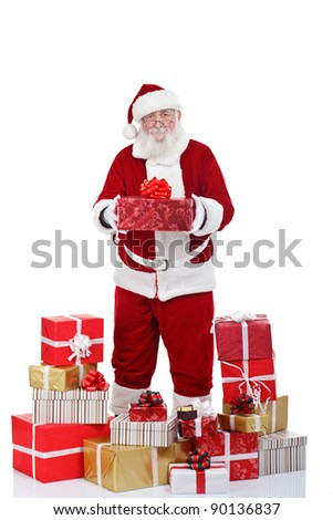 authentic Santa Claus with many gift boxes around him, isolated on white background - stock photo
