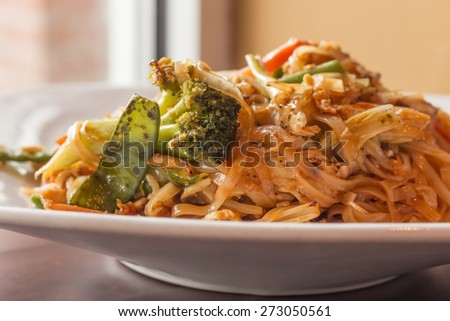 Authentic spicy Pad Thai with chicken served with Asian vegetables - stock photo