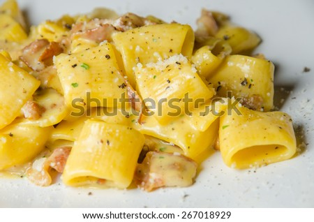 authentic traditional italian carbonara pasta with bacon and egg cream sauce - stock photo