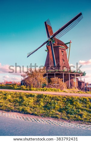 Authentic Zaandam mills on the water channel in Zaanstad village. Zaanse Schans Windmills and famous Netherlands canals, Europe. Instagram toning. - stock photo
