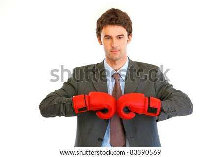 Authoritative modern businessman with boxing gloves isolated on white - stock photo