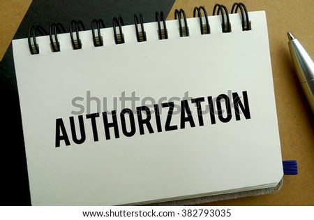 Authorization memo written on a notebook with pen - stock photo