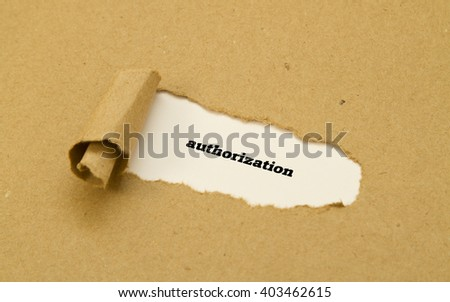 Authorization word written under torn paper. - stock photo
